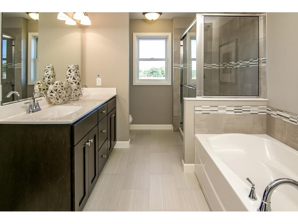 Luxury master bath, double vanity, soak tub and shower with sliding glass door