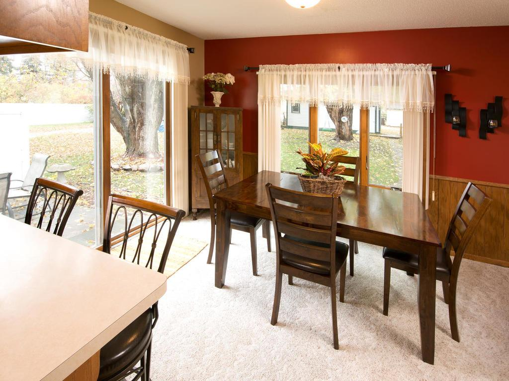 Dining room with patio doors out to your great patio with privacy fence on one side.