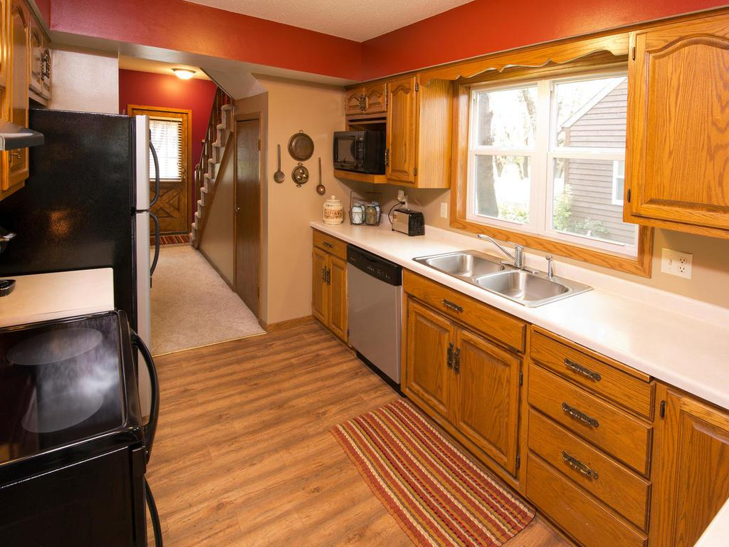 Check out your kitchen!  New laminate flooring...