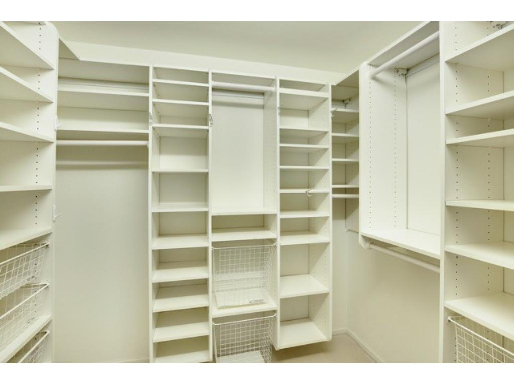 Owner's suite is light filled with walk=in closet and private 3/4 bath.