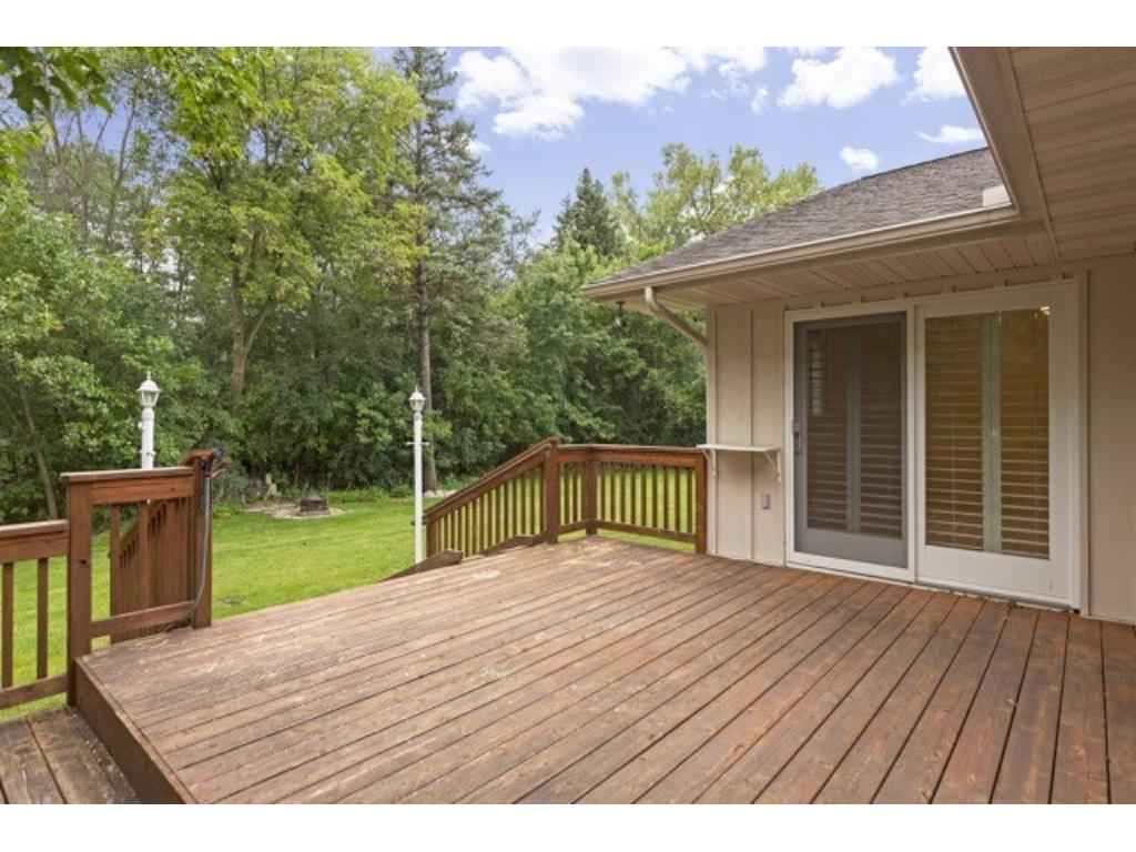 Patio doors to the deck from the dining room and a first floor bedroom, office or den.