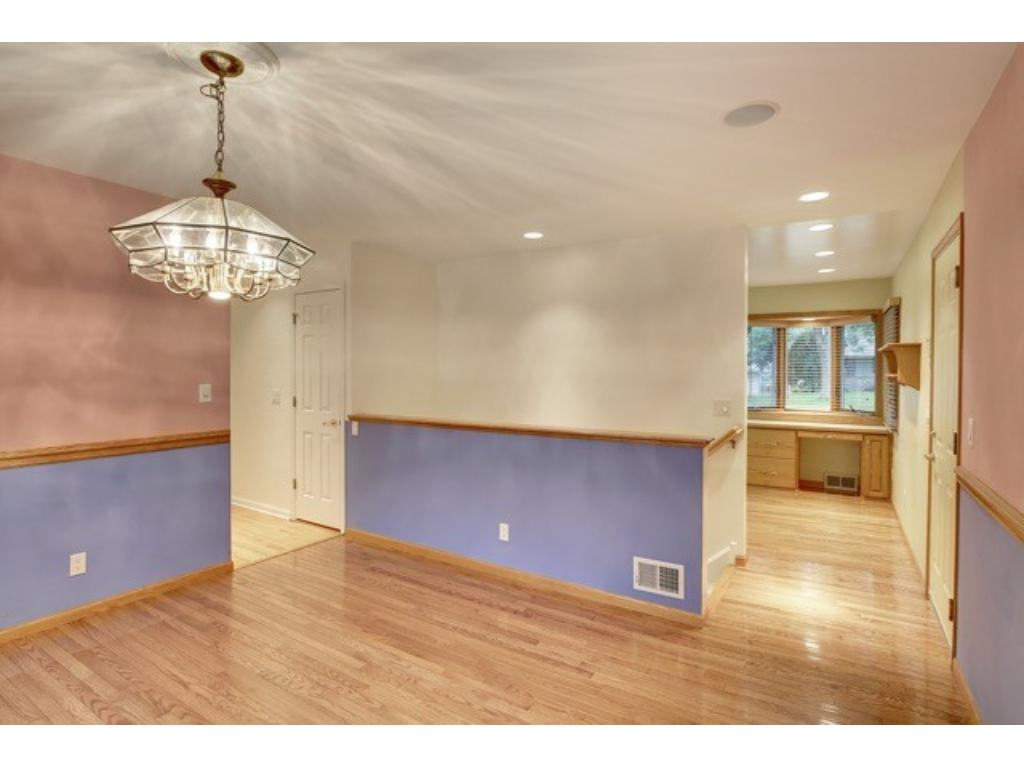 Dining room off the kitchen with sliding glass doors leading to a grilling deck