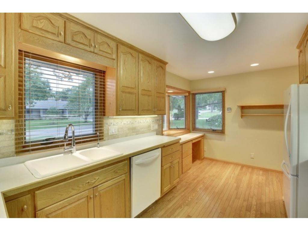 Kitchen has space for an informal dining area. Located conveniently adjacent to the heated attached   two car garage.