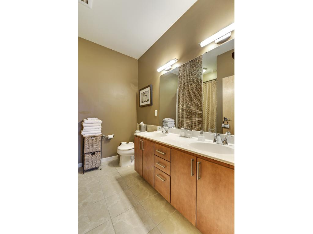 Master bath with double sink and soaking tub.