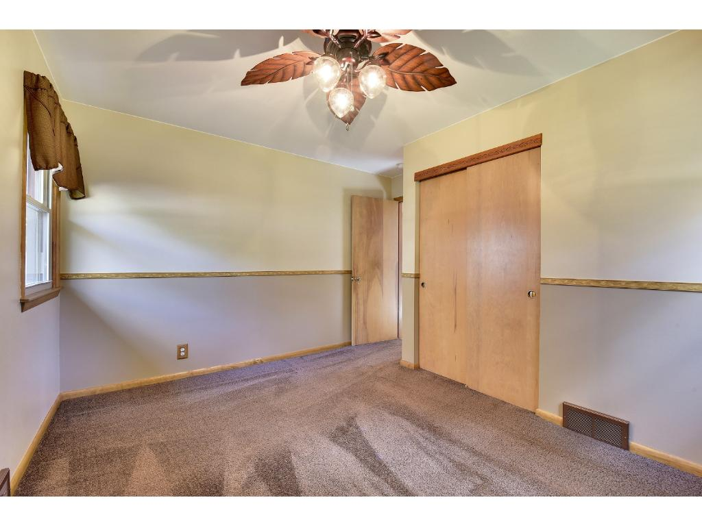 Second bedroom on the main floor.  Beautiful hardwood floors under the carpet in this room as well.
