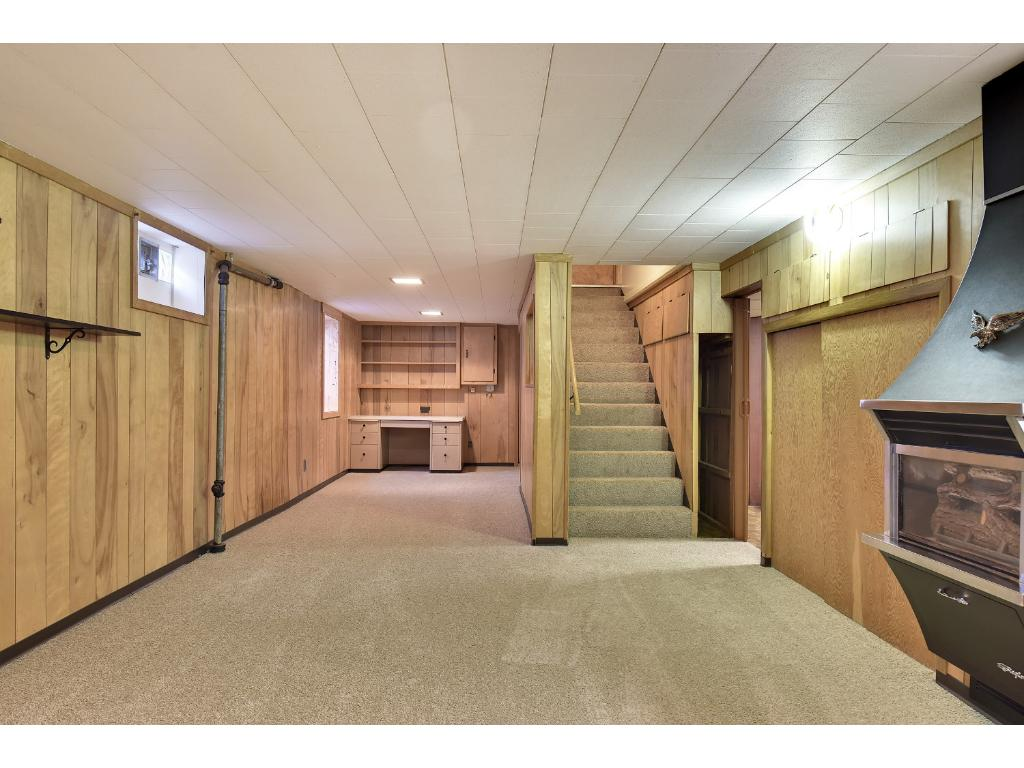 Main floor bedroom with ceiling fan and larger closet. Hardwood floors under the carpet.