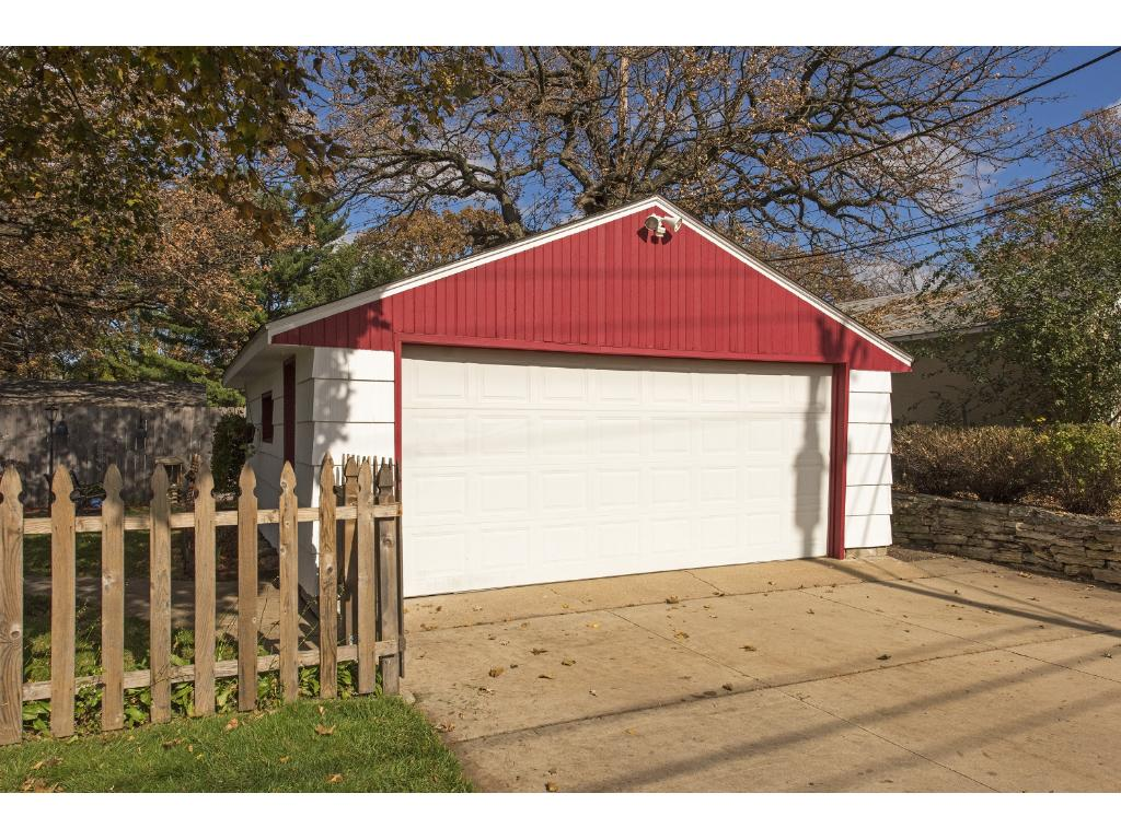 Two car garage with storage area.
