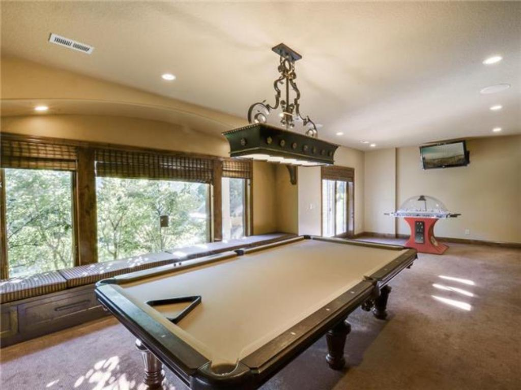 Lower level rec room pool table area w/ room for more games