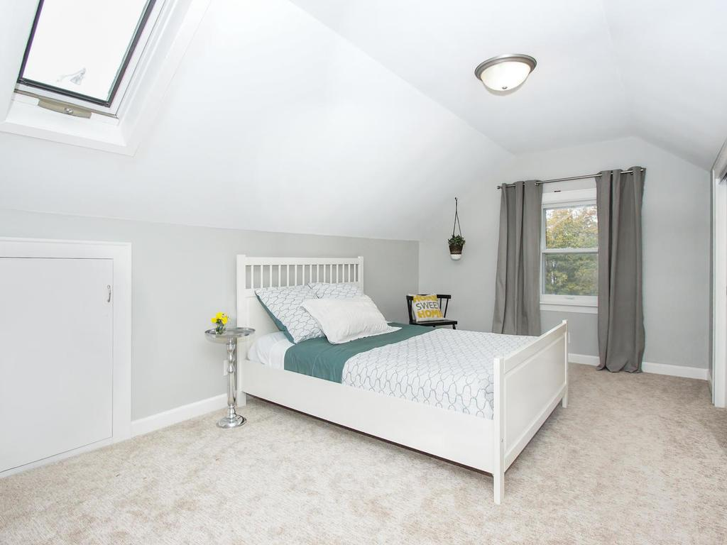 The upper level master ensuite has skylight, plenty of space for sitting area, and 2 closets.