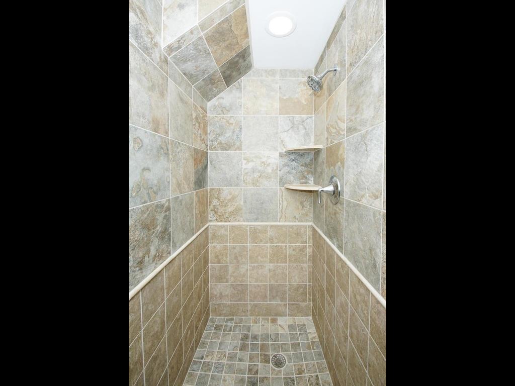 The master bath has vanity, with tiled floor and shower. All brand new!