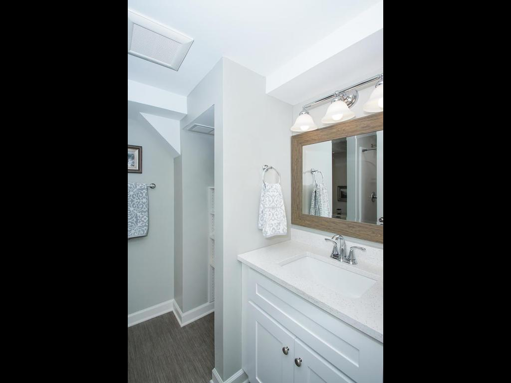 New lower level 3/4 bath with vanity.