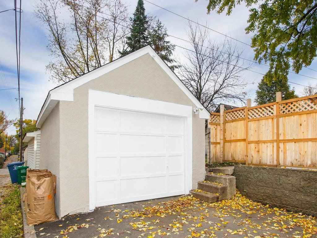 Garage has newer auto reverse garage door, and asphalt driveway.  New roof , and freshly painted.