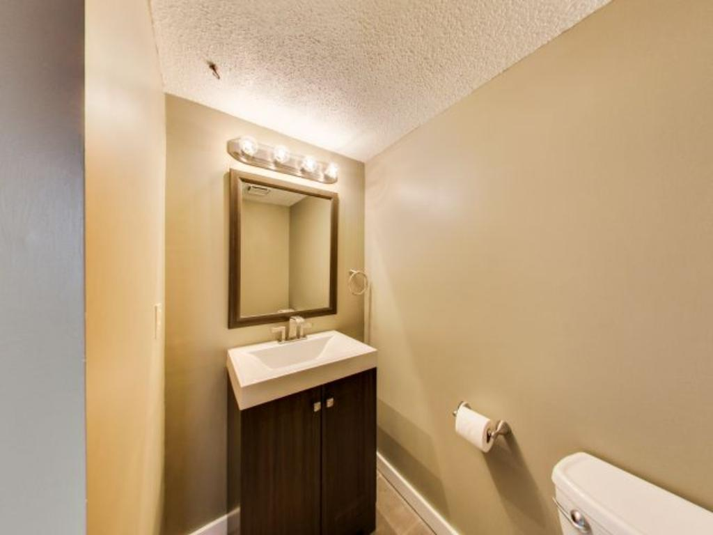This 3/4 bath houses a shower and a modern style vanity.