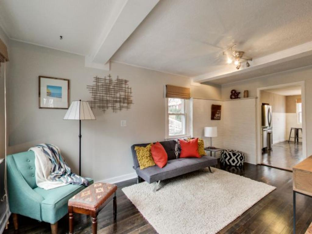 Living room has a pretty accent with the beams in the ceiling.
