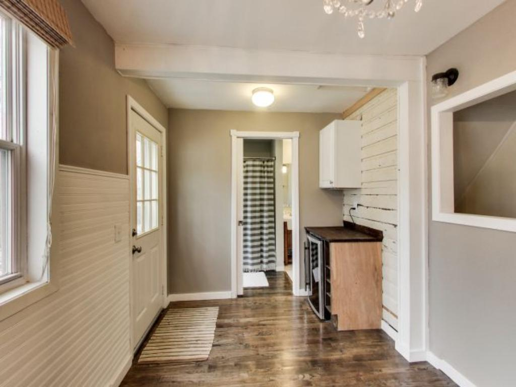 Back entry area features a wine bar along with easy access to the bathroom and dining/kitchen area.