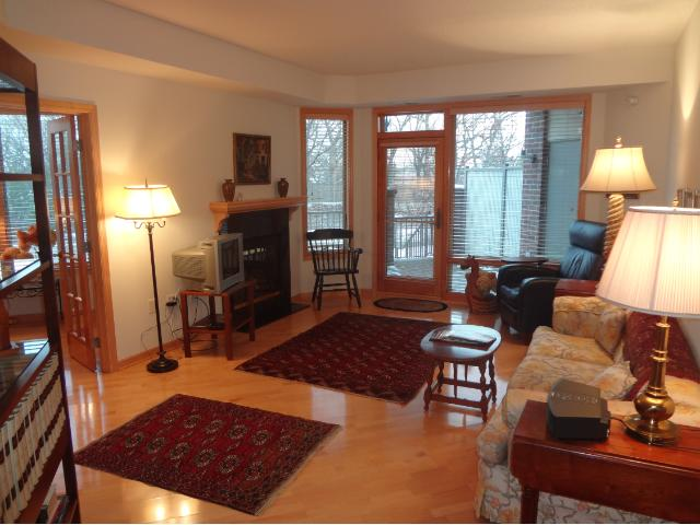 Gorgeous Living Room with a gas fireplace, hardwood floor & door to the 30x11 patio