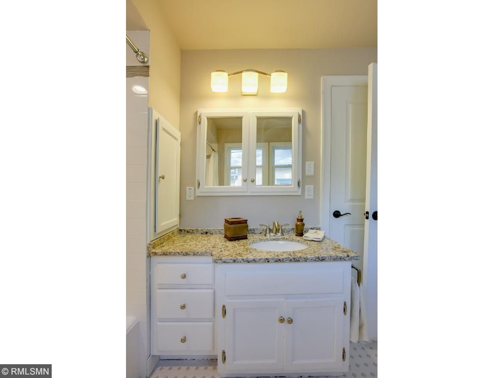 Main floor bath has plenty of cabinet and counter space!