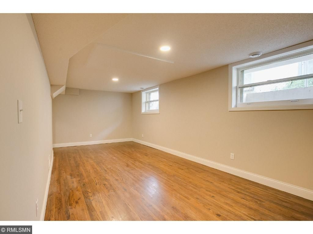 Lower level family room has original hard wood floors and fabulous lighting, great entertainment room!