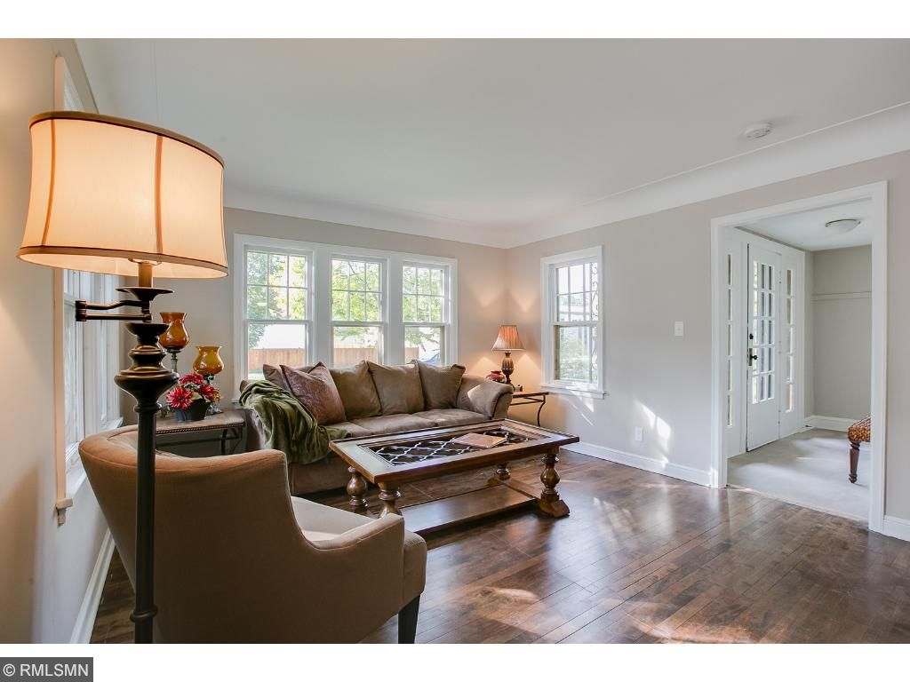 Living room has beautiful natural lighting with original hard wood floors, new lighting and fantastic coved ceilings.