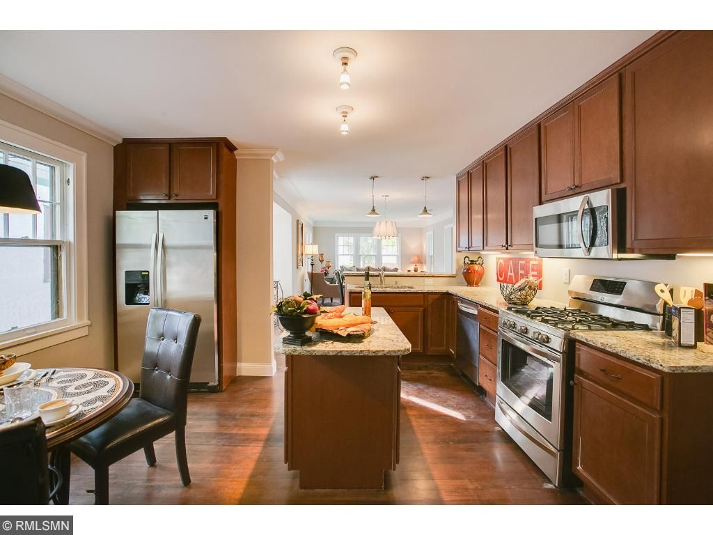 Eat in kitchen area with island and plenty of counter space.  Custom wood cabinets and Granite countertops with under cabinet lighting!