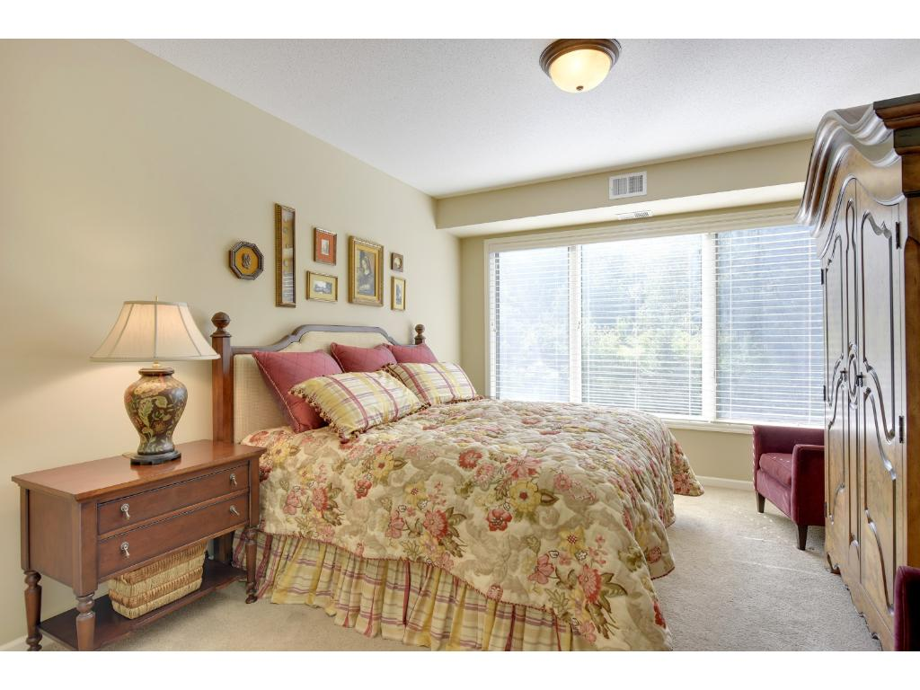 The master bedroom measures 15x12 and has a full wall of west facing windows overlooking the park