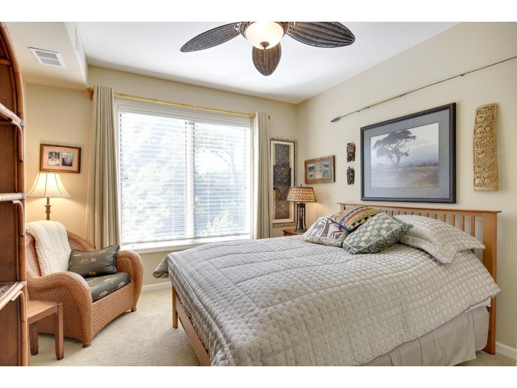 The second bedroom measures 12x11 and has 9' ceilings with a large west facing window that overlooks the park