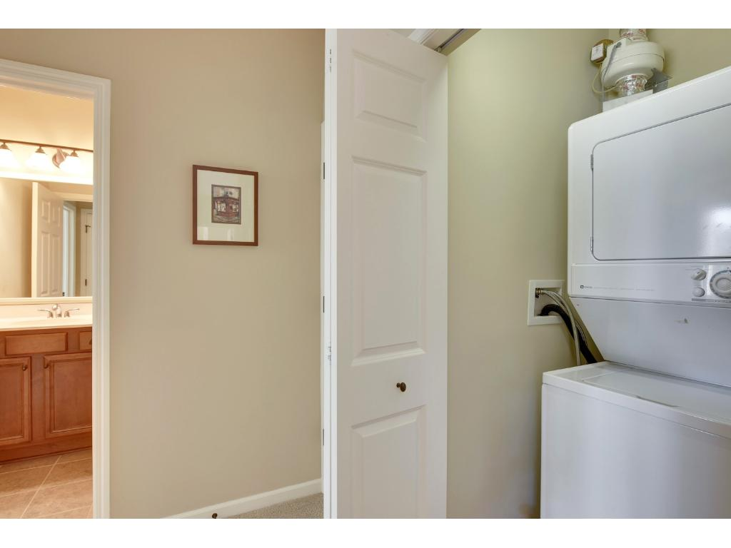 The laundry closet is conveniently located just off the kitchen yet can be hidden away when not in use