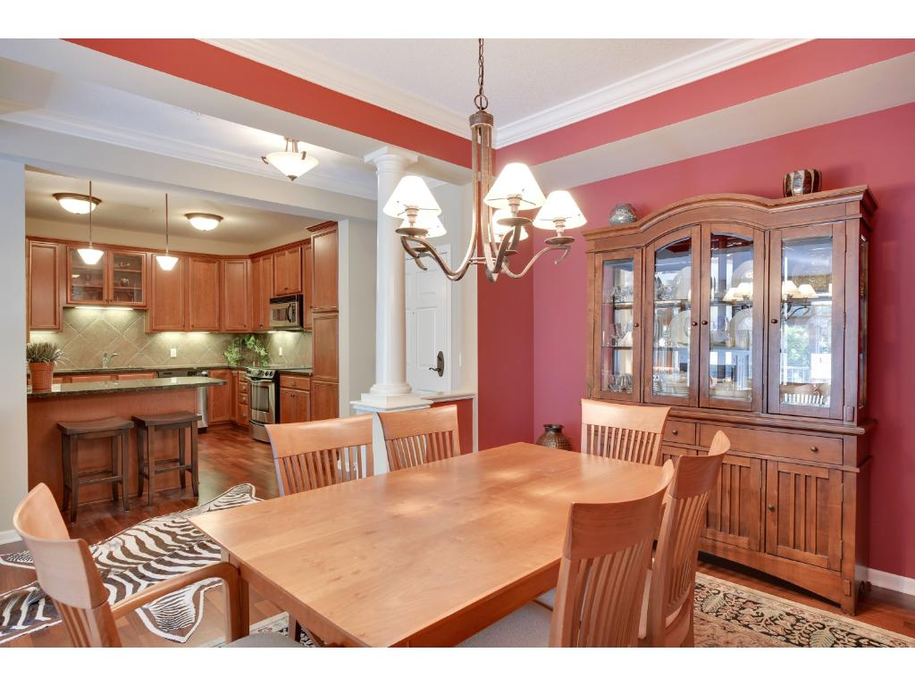 The dining room measure 13x10 and is accentuated with white pillars and crown molding