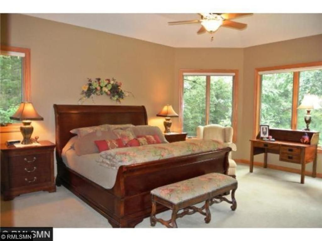 Main level Owner's Suite overlooks Northwoods back yard. Majestic oak trees-soothing vistas.