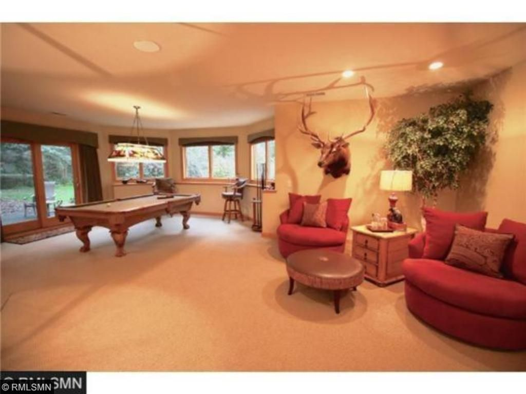 Billiards and conversation areas are part of this amazing lower level walk-out Great Room.