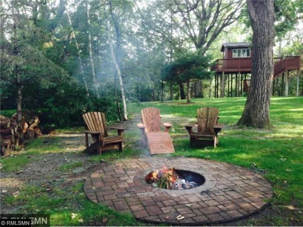 RELAX at your custom campfire area. NOTE: Tree house beyond has decking overlooking river. Trumpeter swans and bald eagle viewing! Spring brings opportunity for morel mushroom hunting on the hillside beneath the tree house!