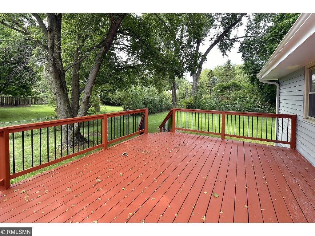Sapcious deck overlooking the backyard.