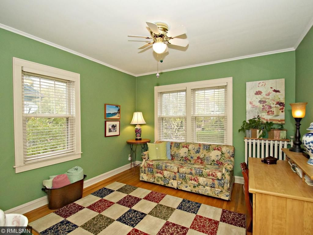 3rd bedroom with ceiling fan and large closet with natural lighting!