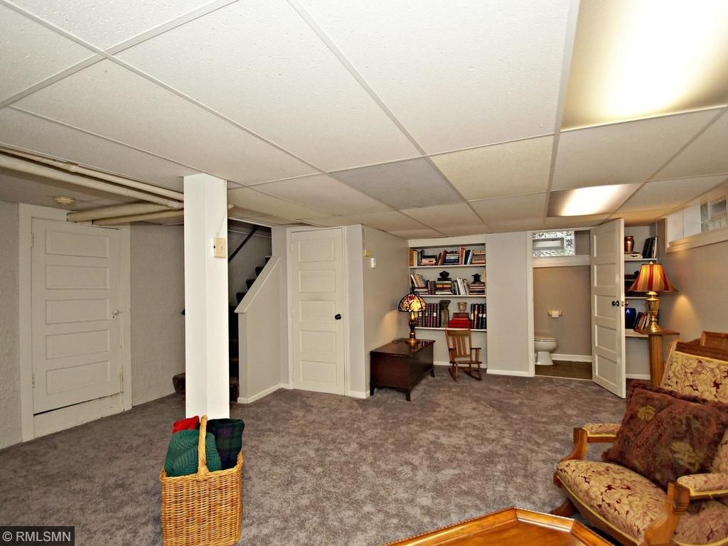 Lower level with built in book shelf.  Also has 3 storage areas below, which is another rarity in MPLS that surround this large finished basement.