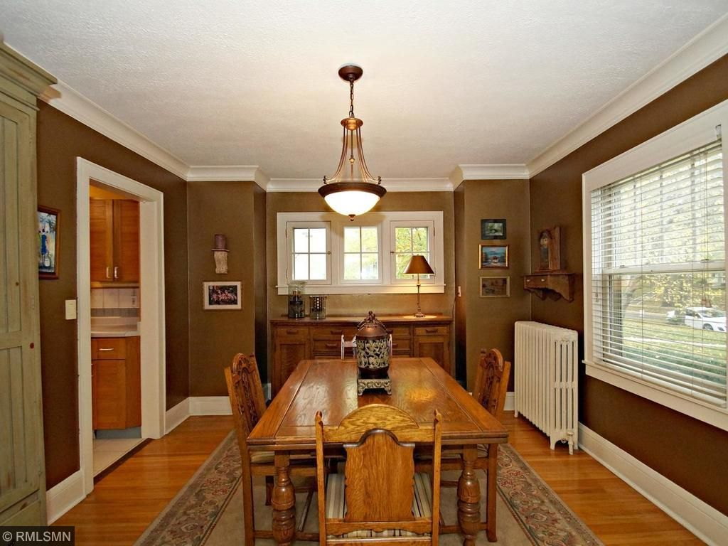 Formal dining room with beautiful wood windows and new storms.
