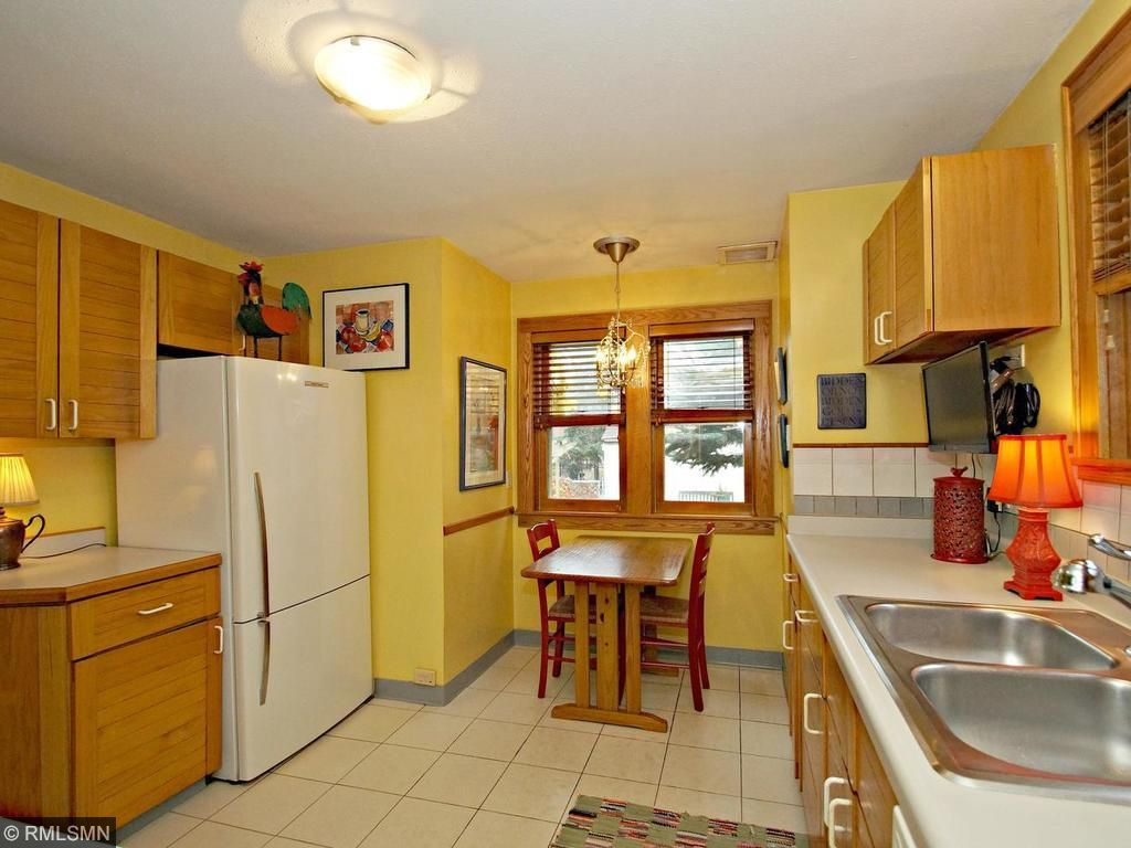 Large kitchen with eat in area and newer fridge & dishwasher! Gather your friends in the kitchen that is unusually big for this era!
