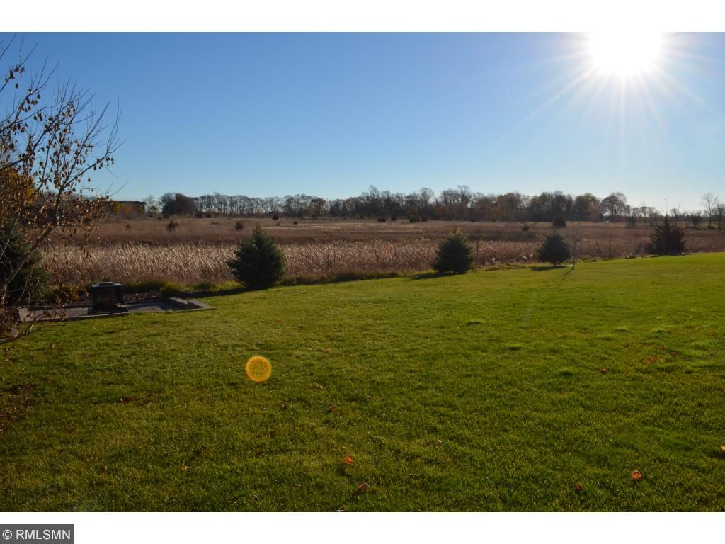 Large back yard that backs up to fields for privacy!