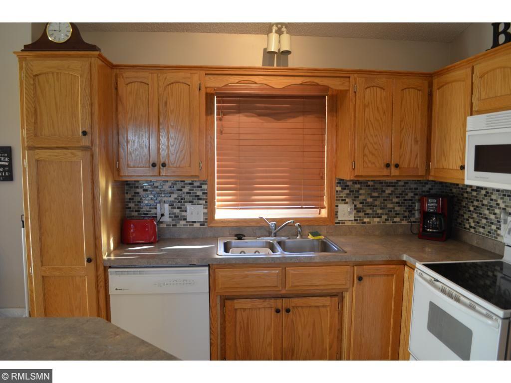 Tile backsplash, kitchen window, and pantry!