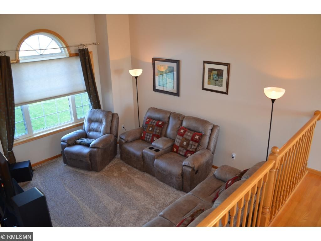 Kitchen open to living room, vaulted ceilings with large window including half-round!