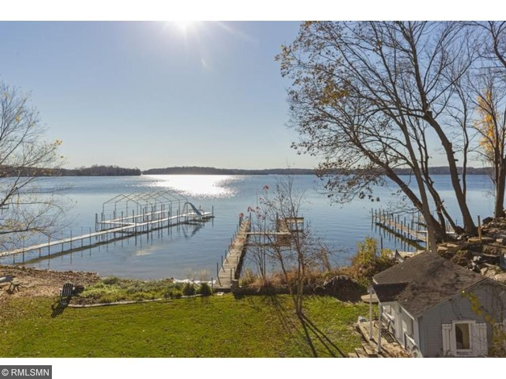 Beautiful Lake Minnetonka home with large level yard and keystone retaining wall for perennial gardens offers soothing lake views.