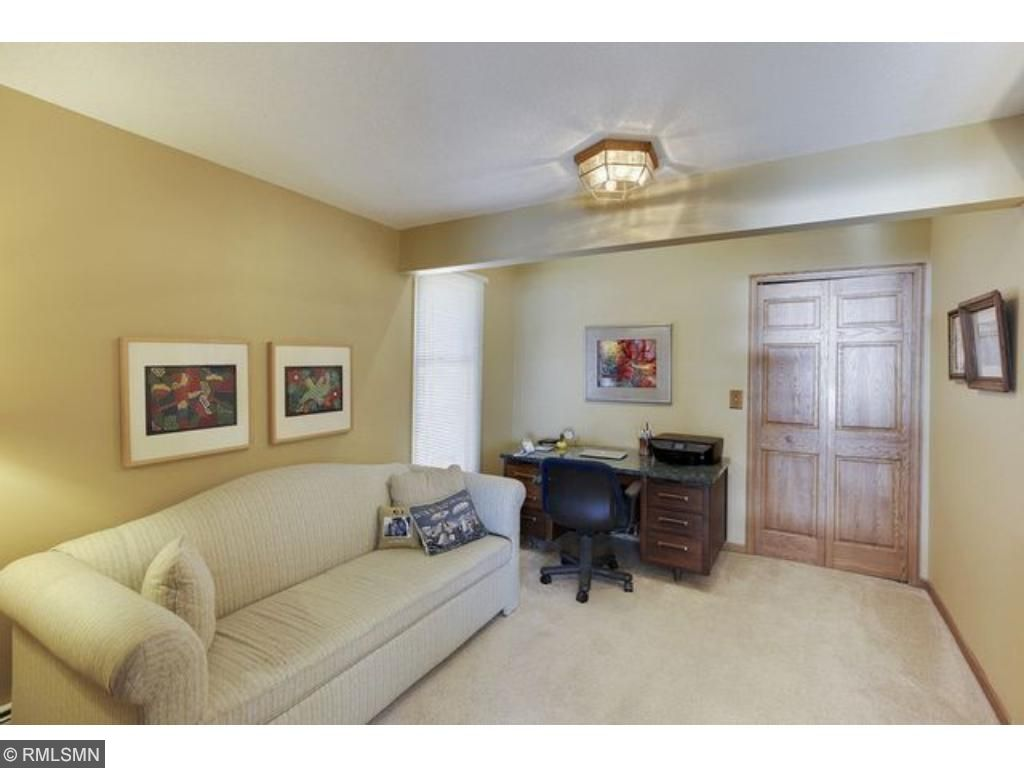 Wide staircase leads from great room to two upper level bedrooms and baths.