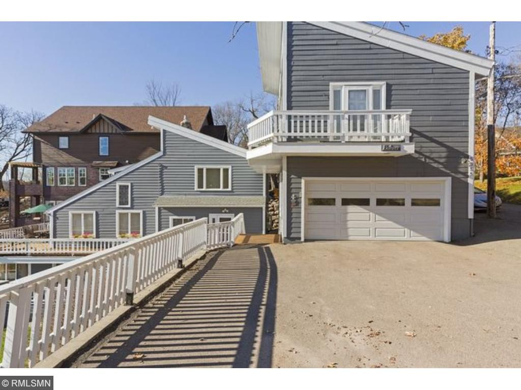 Walkout level also features a full kitchen, ideal for entertaining or easy access to food prep from family room or while enjoying lakeside activities.