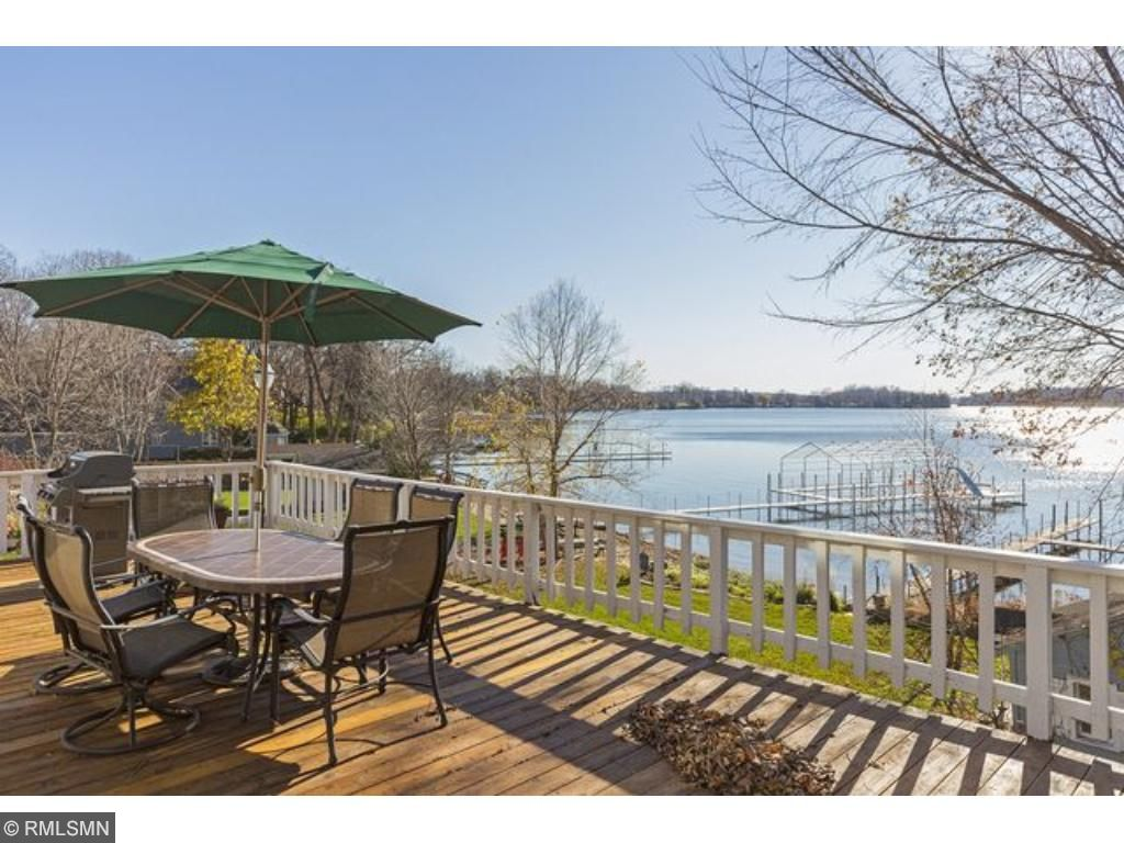 Front deck offers generous spaces for several tables or deck furniture to enjoy the lake.