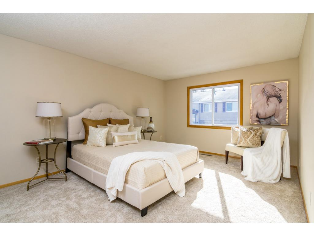 The spacious Owners Suite boasts numerous custom details including a full private bath with custom vanity and new ceramic tile floor plus a large walk-in closet with built-ins!