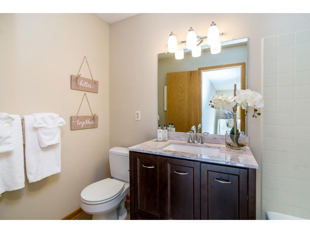 The private master bath boasts a bath-tub and a custom vanity