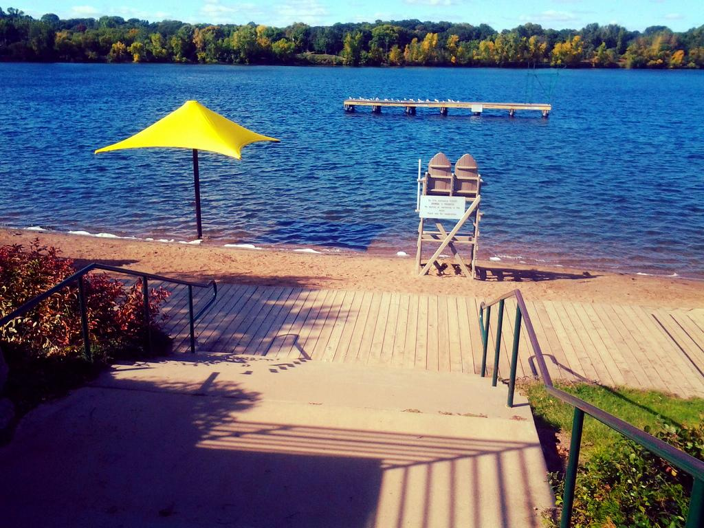 Shady Oak Beach & Park offers a beautiful sandy beach and clear spring-fed waters, as well as great amenities including multi-age playground area, lifeguards, swimming, high dive, concessions, changing area, canoe/kayak/paddle board rentals & more!