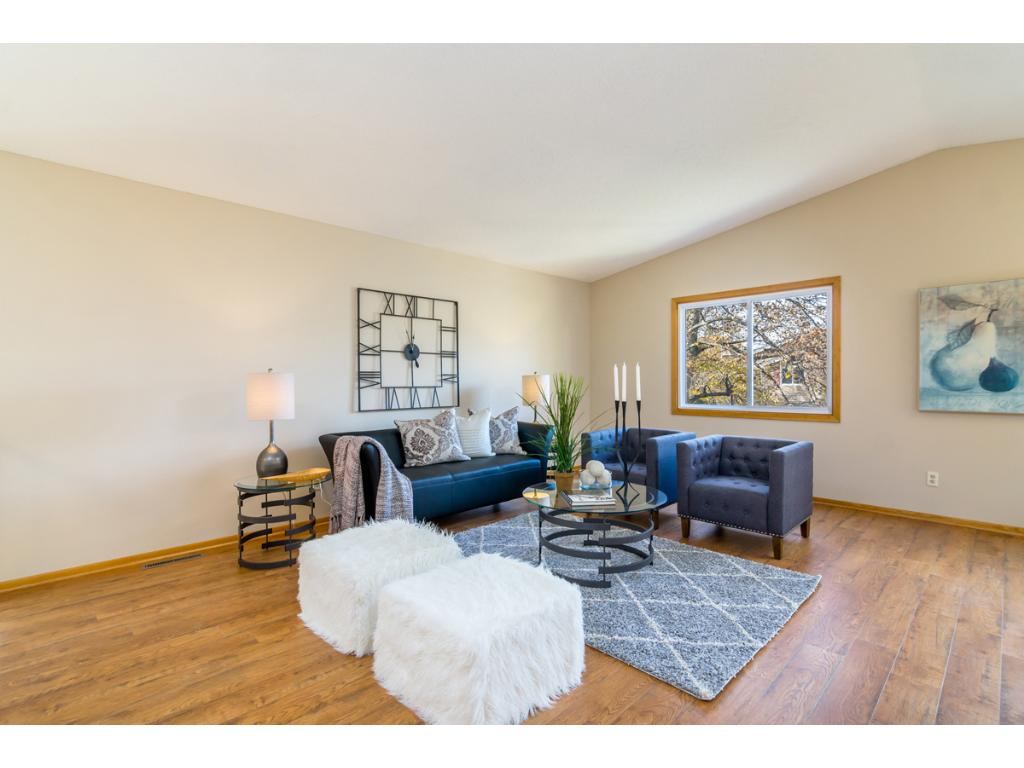Features include spacious living areas, vault ceilings & hard surface floors