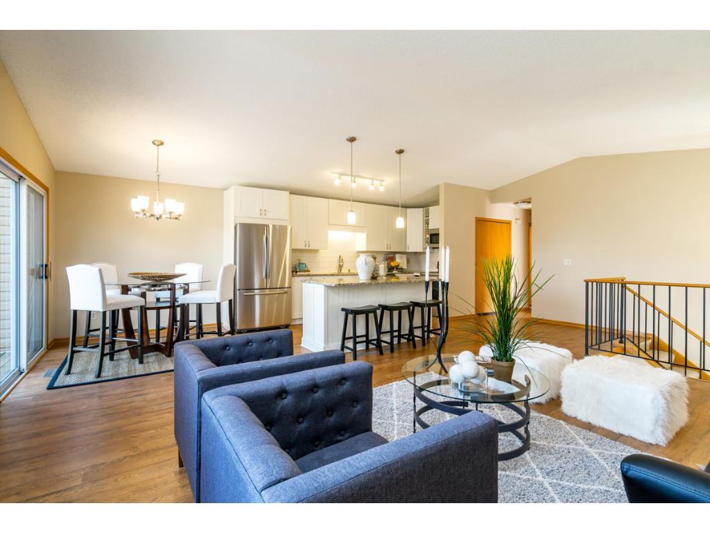 The spacious Great Room provides your guests a warm welcome from the entry foyer and opens to the island kitchen and dining area.