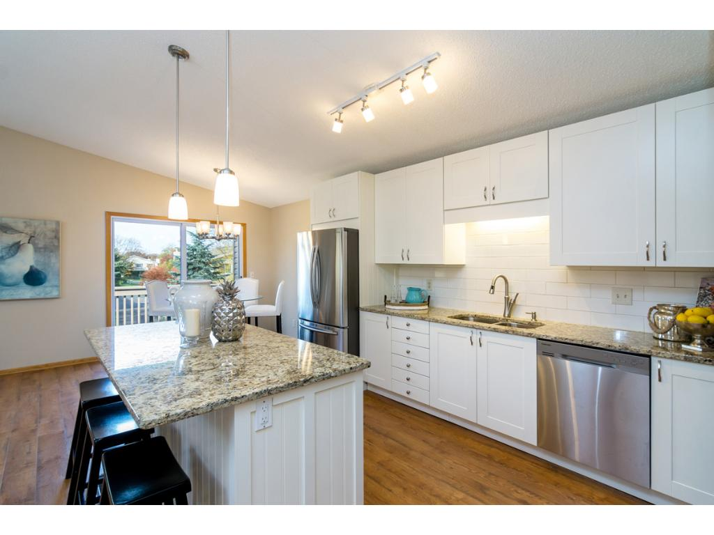Chefs will love this Kitchen. Features include beautiful cabinetry with many built-in features, a large center island, a vast amount of granite countertops and a full compliment of upgrade stainless steel appliances