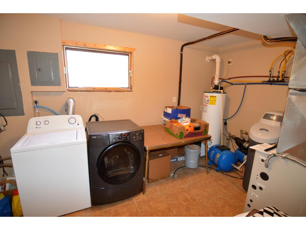 Shared utility and laundry room.